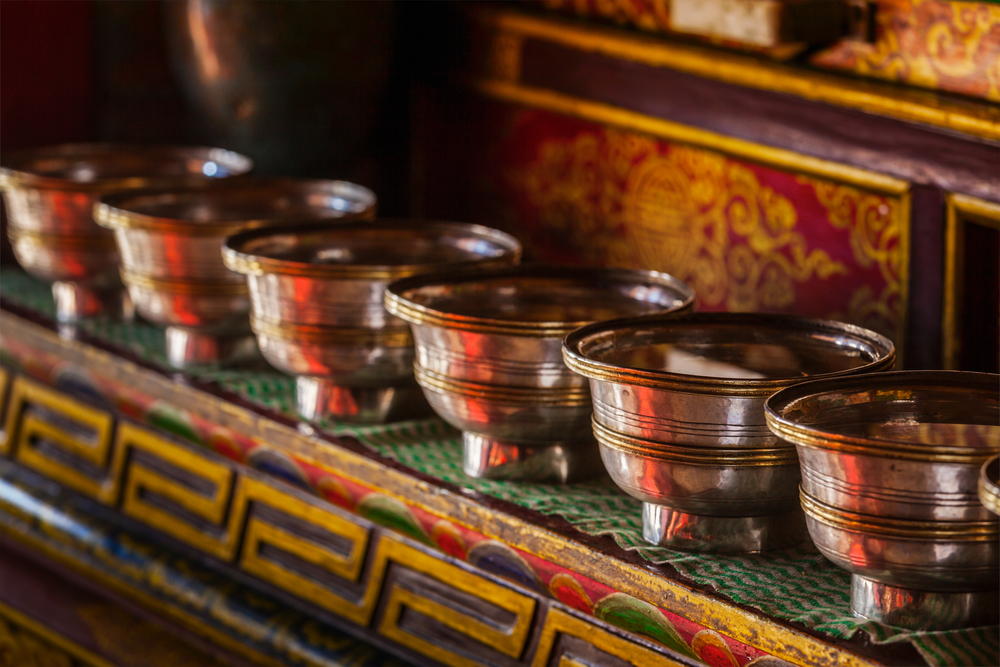 Offerings (Tibetan Water Offering Bowls) in Lamayuru gompa (Tibetan Buddhist monastery). Ladadkh, India